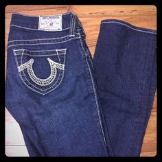 True religion jeans size 25 Real cute dark wash jeans! They're just a bit small, in pretty good condition! They are a size 25 with white stitching on the sides and pockets. True Religion Pants Straight Leg
