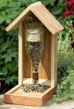 Wine bottle bird feeder  by Sandy & Bruce Swan's Etsy shop As seen in Birds & Bloom magazine.