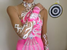 This is a very high-quality, handmade in Russia rhythmic gymnastics leotard. Nothing is painted on the leotard. The fabric is high-quality and the leotard has pink lace on the skirt.