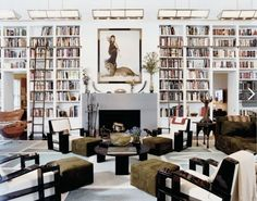 Wall of books in DVF's living room.