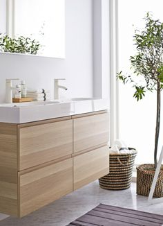 A peaceful and serene bathroom would not be complete without the modern and clean look of the IKEA GODMORGON sink cabinet. Wooden Bathroom Vanity, Laundry In Bathroom, Bathroom Furniture, Small Bathroom, Bathroom Ideas, Bathroom Storage, Ikea Vanity, Girl Bathrooms, Bathroom Styling