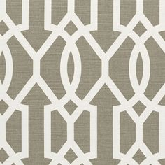 Downing Gate Fabric A striking fabric featuring an interlinking geometric pattern printed in white and grey.