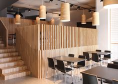 Slatted wooden screens separate the three staggered tiers of this restaurant