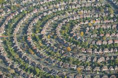 LONDON: An aerial view of houses in a north-eastern suburb of the city. Photographer Jason Hawkes, from Oxfordshire, travelled above four continents by helicopter in a 12-year project to record how housing developments have produced abstract patterns on the landscape