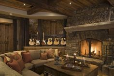 how incredibly cozy. I think @Whitney Clark Clark Farrell will appreciate the guitar display