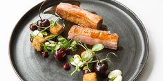 A recipe for crispy duck breasts, confit duck leg croquettes, cherries and almonds from chef Paul Welburn.