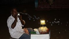 Found this vendor attracting children by blowing bubbles in the air on a cool winter night by the sea shore at Visakhapatnam, Andhra Pradesh, India @Softtek.