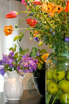 Put fruit in a vase with flowers