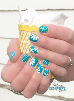 Dots and Daisies by BeingGenevieve.com This has a free step-by-step tutorial on how to do this nail design with gel polish or regular polish. I had no idea flowers were so easy to paint!!!