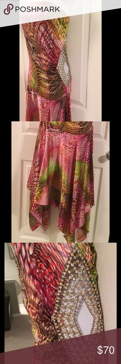 Stunning strapless multicolored, side jeweled dres Absolutely gorgeous.. new, never worn. Bought in South Beach FL with intent to go dancing! Is light weight, and has gorgeous side jeweling, that will guarantee you to sparkle! sun Dresses Strapless