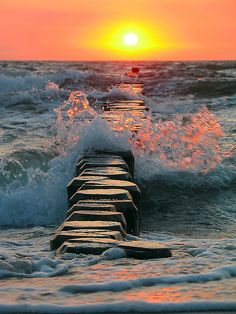 crashing waves at sunset