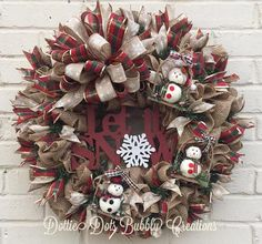 Rustic Let It Snow Winter Wreath, Christmas Wreath, Snowman Wreath, Burlap Wreath This is a Rustic Let It Snow Winter Wreath, accented with 3 mini snowmen, snowman ribbon, plaid ribbons, A wooden let it snow sign, and 3 mini snowmen arranged on a 20 evergreen wreath base covered with