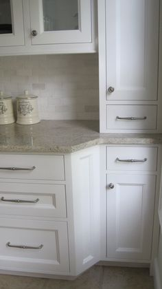 Looks like Kashmir white granite and marble backsplash, possibly tumbled Thassos or China White