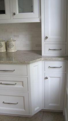 Looks like Kashmir white granite and marble backsplash, possibly tumbled Thassos or China White