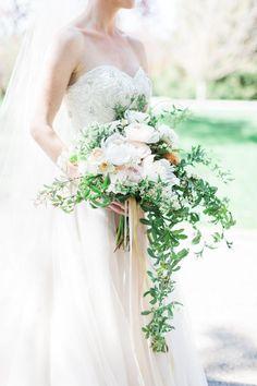 Ranunculus, dahlias, white bouquet, vines, beaded bodice, tulle ballgown // Cory & Jackie Wedding Photographers