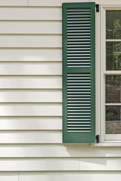 Exterior - 2015 Charlottesville Idea House Tour - Southernliving. Earthy details like the charcoal standing-seammetal roof, green shutters, and putty-colored trim (Worldly Gray