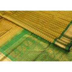 #Golden mustard #shimmering in the body and a #darkgreen and zari border! The #richness of the pallu in the zari and intricate motifs makes it even more #special.