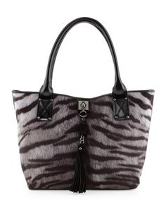 "Tiger-Print Tassel Tote, Gray by Moschino  •Tiger-print suede-like fabric with leather trim. •Tubular shoulder straps; 8"" drop. •Open top with round turnlock closure at center. •Love Moschino etched plate with ring and tassel drop on front. •Love Moschino etched plate on lower back. •Inside, one zip and one open pocket; sateen lining.  •11 1/2""H x 12 3/4""W x 6""D; weighs 1lb. •Imported."