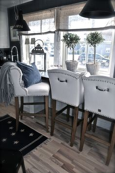 2 great ideas. Handles on the back of chairs, and the bar at the window ledge