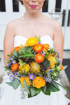 gorgeous wedding bouquet!  succulents and color. october wedding