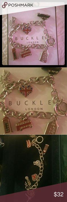 NIB Buckley of London Charm Bracelet with charms NIB Buckley of London Charm Bracelet with charms Silver. Still in Box, never worn Buckley of London Jewelry Bracelets