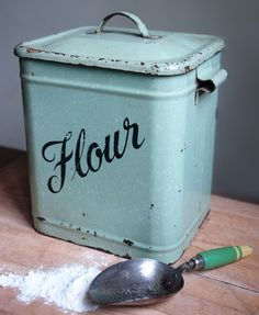small vintage green enamel flour container with green painted wooden handled scoop