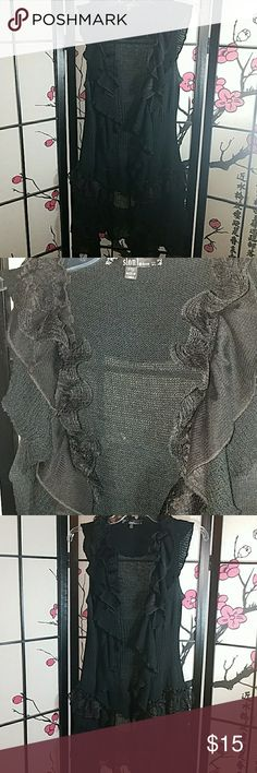 Black Lace and Knit Sleeveless Cardigan Very cute, sleeveless, knit and lace black cardigan. You can wear it open or close it with the 4 hook n loop fasteners that run down the middle. Its a size petite small and its stretchy. I'm 5'3 and the bottom of it hits my upper thigh. This, in my opinion, is a piece that can be worn year round, dressed up or dressed down. Slonl Sweaters Cardigans