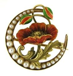 Art Nouveau, 14k yellow gold and enamel brooch of a poppy set inside a crescent moon set with pearls.