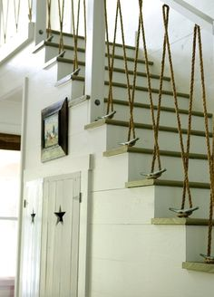 Great idea for a beach house stair railing. haleytheboxador Great idea for a beach house stair railing. Great idea for a beach house stair railing. Haus Am See, Banisters, Rope Railing, Stair Banister, Hand Railing, Stair Treads, Decking Handrail, Railings For Stairs, Cable Stair Railing