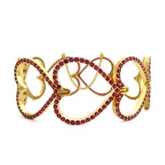 This one-of-a-kind bracelet by Daniel Gibbings is made in 20-karat yellow gold with rubies