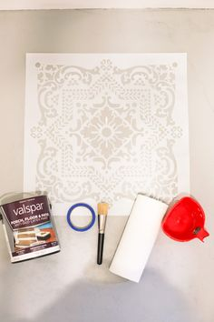 Laundry Room DIY: How to Paint a Cement Floor with Stencils. Popular lifestyle blogger Tabitha Blue of Fresh Mommy Blog is SO excited about her garage turned family-friendly laundry room. What started as leftover garage space, turned into removing the popcorn ceiling, to building custom faux cabinets to cover breaker boxes and a built in to hide the ugly utilities, to stencil painting the cement floor and more.