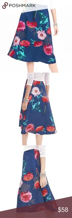 NWT! Banana Republic Gerber Daisy Midi Skirt Beautiful! The season's hot midi skirt silhouette, fashioned in a bold daisy pattern. Banded waist. Side zip. Partially lined. Offers welcome! Banana Republic Skirts Midi