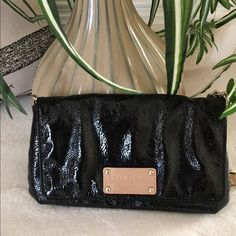Authentic Kate Spade Handbag/Clutch Black patent leather with chain and leather hardware. The strap is chain with a leather strap. Interior is ivory and black polka dots. Has 4 credit card slots inside. Small shoulder bag/ clutch. Excellent condition and super cute. kate spade Bags Mini Bags