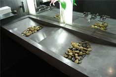 concrete bathroom sinks. I like the river rock idea but not sure about how clean that is.