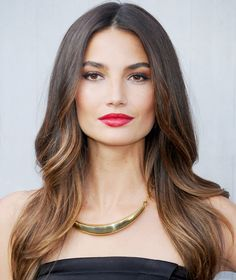 "Cue the confusing gradient color naming—""Sombré,"" like Lily Aldridge's honey-infused locks, offers a less severe version of the ombré trend. It stands for ""subtle ombré,"" infusing lighter locks with more of a highlight effect as opposed to ombré's stark color blocking. Aldridge's golden strands add the perfect playful light to accentuate that demure supermodel smize."