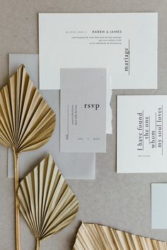 modern wedding invitation with dried palm fronds for styling