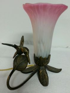 """ESTATE SALE FIND  ART DECO BOUDOIR LAMP  BEAUTIFUL BRONZE BASE WITH HUMMINGBIRD  SHADE MADE OF GLASS PINK AND CREAM FLOWER  MEASURES APPROX 7 3/4"""" TALL  WIDE 6 """"  MINT CONDITION!  WORKING BEAUTIFULLY! !  THIS LAMP RARE VERY HARD TO FIND  SEE PHOTOS  010"""