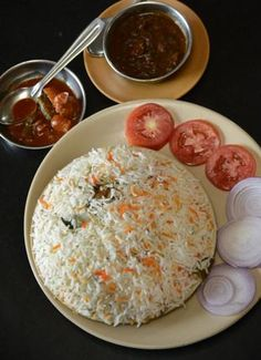Bhatkal biriyani: K.C. Vijaya Kumar is taken by surprise with an oil-free biryani, redolent with onion and a dash of curry leaves.