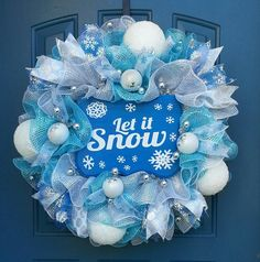 This is a large wreath measuring approximately 26 inches. This wreath is made using a ruffle technique and is accented with a blue and silver