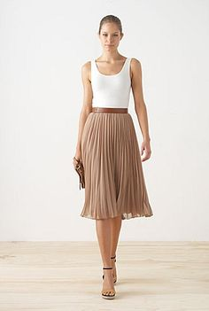 long nude pleated skirt, white tank, nude shoes