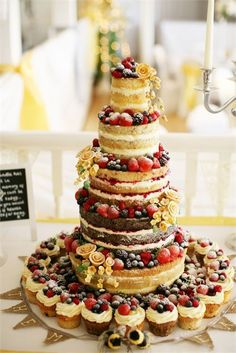 Sophie and Christopher cut into a five tiered naked wedding cake. See more of Sophie and Christopher's real wedding. How To Make Wedding Cake, Wedding Cake Red, Wedding Top Table Flowers, Victoria Sponge Wedding Cake, English Wedding Cakes, Woodland Cake, Traditional Wedding Cake, Cake Trends, Fancy Cakes