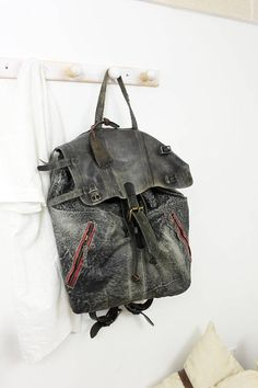 Skorpios backpack , our new creation just for unique and limited lifestyle people . Make with vintage rare old leather and unique old stuff from the second world war. all the belt used on this backpack , are handmade and handborded . Inside is make with a fantastic cotton lining