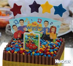 Really easy and fun cake to make. Unfold Wiggles paper cups and glue them back-to-back for the banner on top of the cake. 2nd Birthday Cake Boy, Wiggles Birthday, Wiggles Party, Second Birthday Ideas, First Birthday Parties, Wiggles Cake, The Wiggles, Emma Wiggle, Twins 1st Birthdays