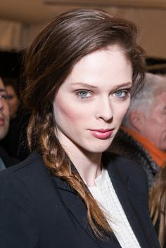Coco Rocha went for a side braid with pink lips and cheeks and soft eye makeup.