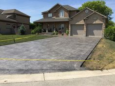 Rough Cut Stone Stamped Concrete Driveway with Stone Block Border in Delaware Ontario Stamped Concrete Driveway, Concrete Driveways, Stone Blocks, Driveway Ideas, Rough Cut, Delaware, Ontario, Garage Doors, Outdoor Decor