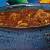 Crockpot Tamale Soup  1 lb. ground beef  1 onion chopped  1 green bell pepper  2 Tblsp. veg oil  1 bag frozen corn kernels  1 pkg. taco seasonings  1 10 oz. can tomato sauce  2 cups water  1 beef boullion cube  1 16 oz. can pinto beans  1-2 tsp. chili powder  1 tsp. cumin  salt & pepper to taste  4-5 frozen tamales shucked and cut into 1 inch pieces