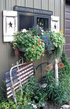 Too much crap, but I like the window box flowers.