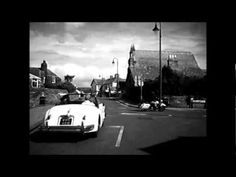 Eight Harley Davidsons Escort  Lisa and Isabell in their 1957 Jaguar.wmv