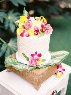 Tropical flower topped wedding cake | Angelica Chang Photography