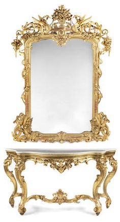 An Italian Rococo style carved giltwood console and mirror, late 19th Century